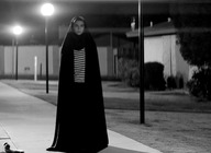 A Girl Walks Home Alone At Night artist photo